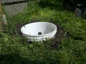 bucket sunk into ground