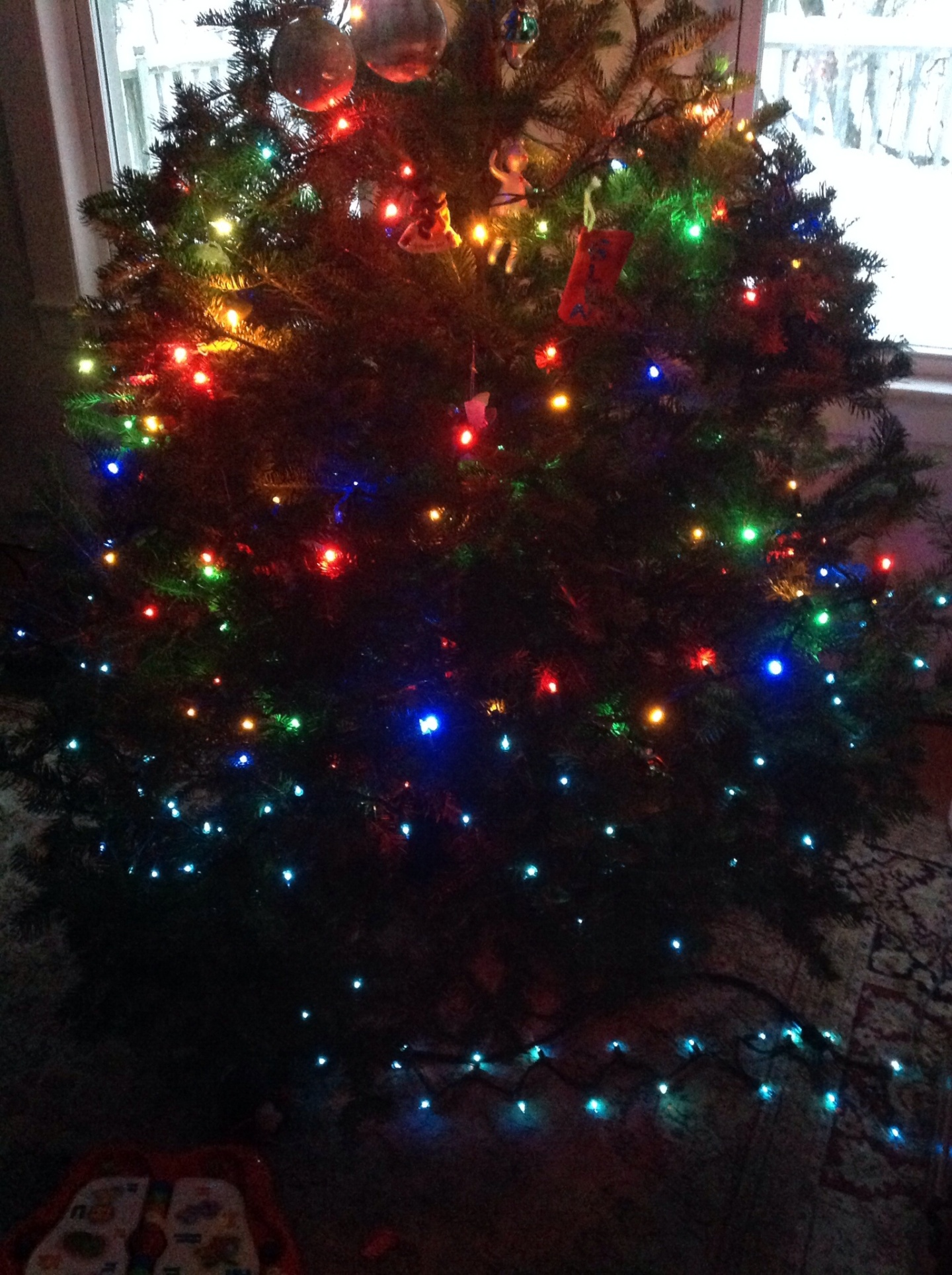 A decorated Christmas tree with colored lights