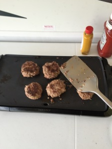 spatula flipping burgers