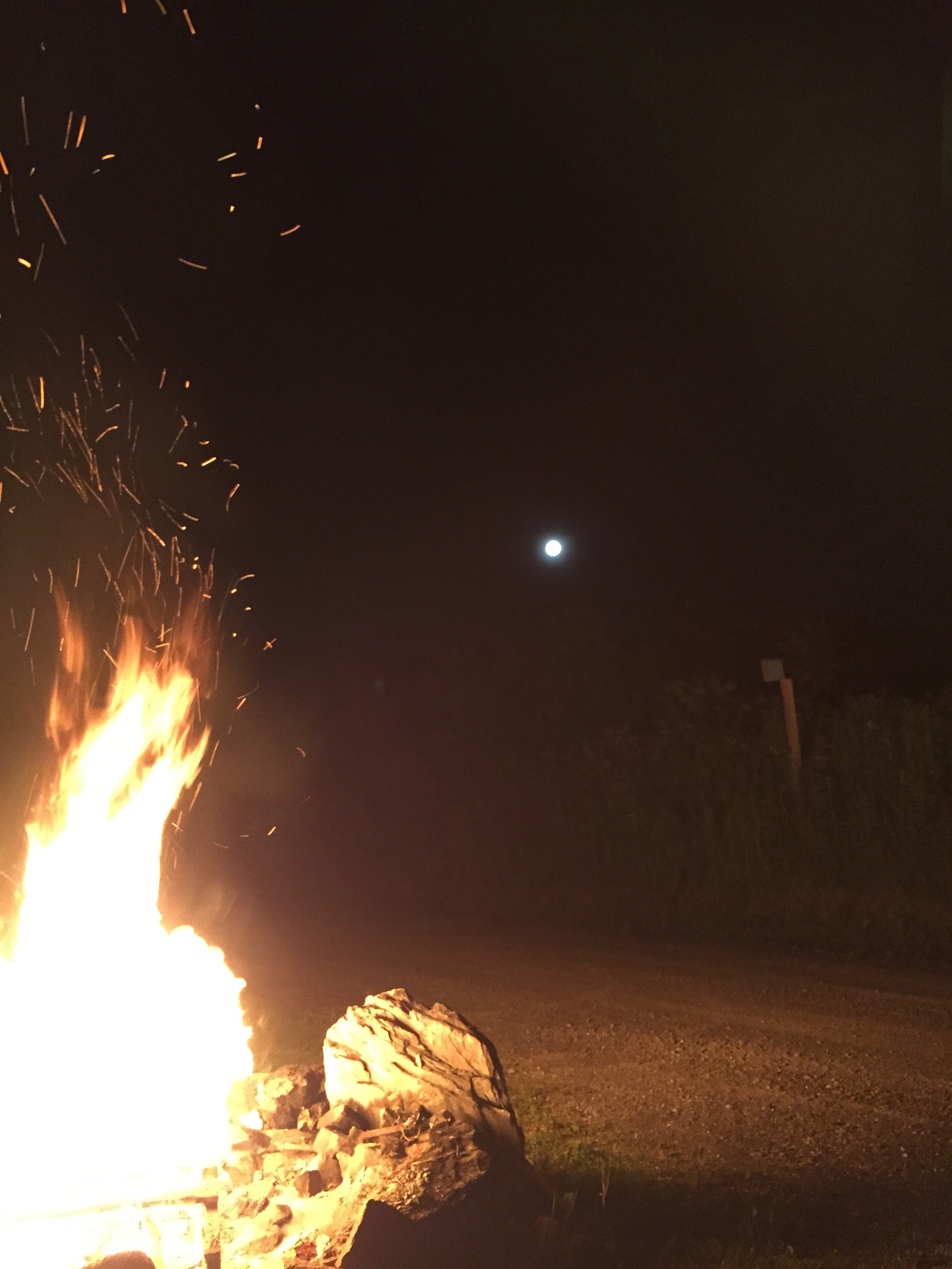 moonrise over a bonfire