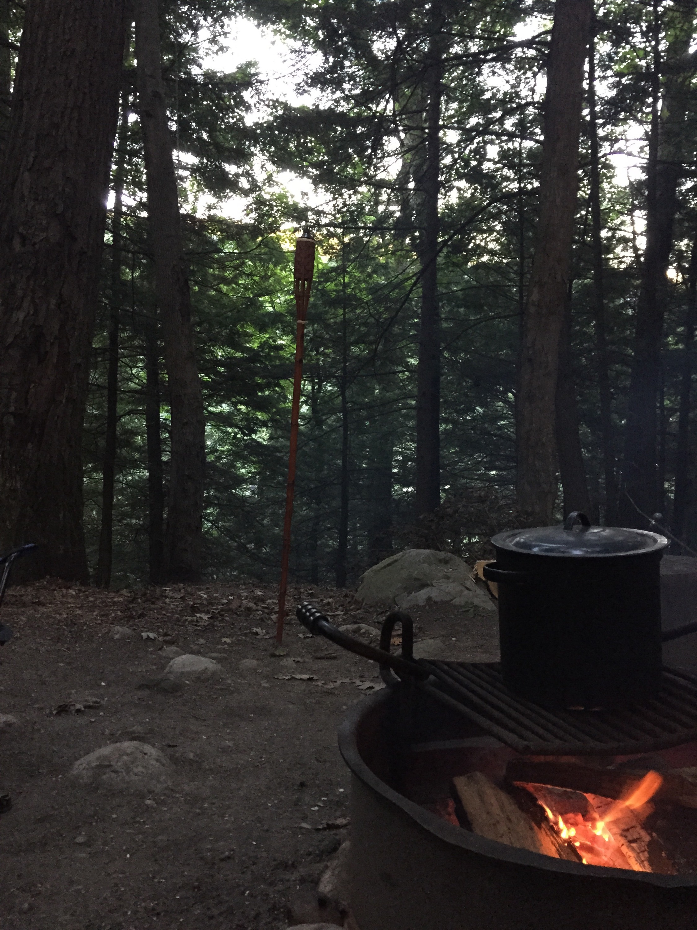 a pot cooks oveelooking a cliff